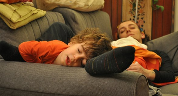 Father and son sleeping on a counch