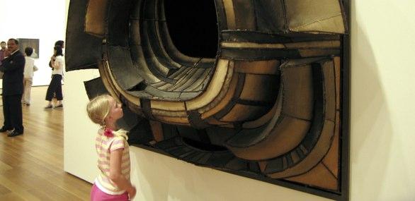 Girl looking at Museum exhbit