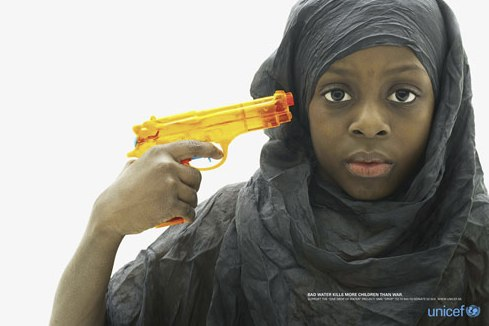 Unicef picture of girl holding water pistol to her head